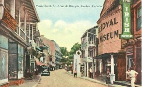 QUEBEC SURNAMES: Chamberlan, Chauvin, Huard, Langlois Kahnawake, Langlois Metis, Lefebvre, Lessard LOCATIONS: Ste-Anne-de-Beaupre, St-Malo, France, Le Havre, Pabos, Trois-Rivieres | Vintage colour postcard of Main Street, St. Anne de Beaupre, early 20th century