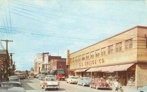 Vintage postcard - Kresge's Department Store and other store plus classic cars