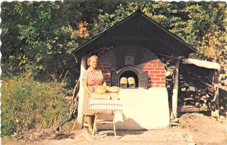 Retro vintage postcard: Gaspe, Quebec, traditional red-brick roadside oven - Lady beside loaves of freshly baked bread