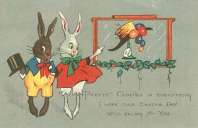 Scrapbooking | Brown male rabbit (old fashioned top hat, yellow & blue outfit) & white rabbit (old fashioned red dress and bloomers) admire Easter bonnet in the window | early 20th century postcard
