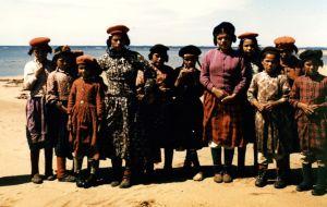 Natashquan, Quebec | First Nations children standing in a row on a beach | Montagnais