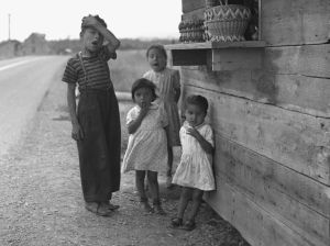 Mi'kmaq Micmac children in Maria, Quebec near the side of the road at a craft stand | Canada First Nations